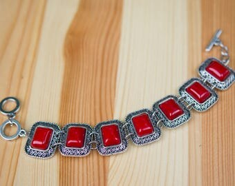 Red and silver metal women's wrist bracelet.