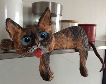 The casual Siamese cat, paper mache and acrylic.