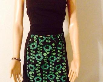 Bright green floral naive printed black cotton skirt