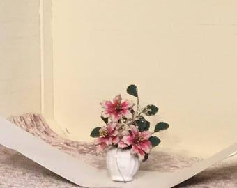 Beautiful lg. pink poinsettia plant in decor pot