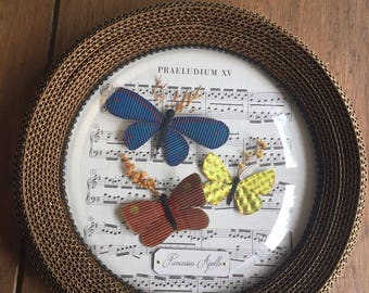 Round frame with butterfly decoration