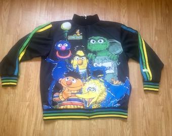 Etremely RARE Sesame Street jacket 1990's 1990s adidas inspired look Mens size XL Big Bird , Cookie Monster , Oscar the Grouch , Burt Ernie