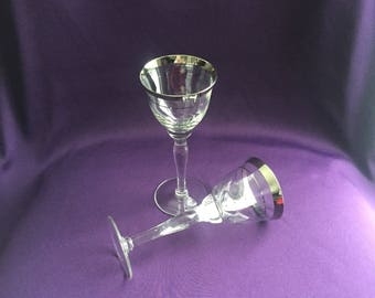 Vintage pair of silver trimmed champagne/toasting glasses