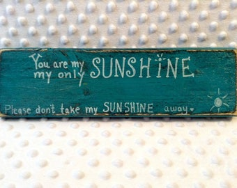"Hand made plaque / sign.  ""You Are My Sunshine"" painted on face."
