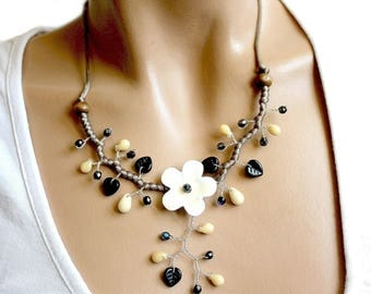 Flower necklace white enameled metal and black leaves