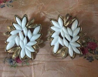 Gorgeous vintage 1950's signed Monet Patd. Clip on earrings with milk stone glass and gold leaf pattern.