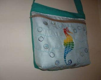 Hand stencilled rainbow seahorse cross body bag with zip closure