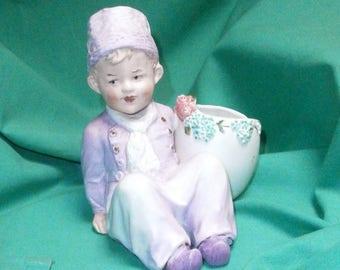 Gebr. Heubach, rare piano baby Dutch boy w. egg shaped basket/Vint./antique/bisque/Germ.
