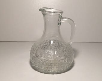Glass carafe with floral motif