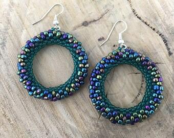 Green metallic bead woven hoop earrings with silver plated hooks, beaded jewellery