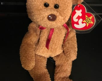 "Rare with Errors Ty ""Curly"" Beanie Baby"