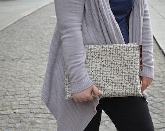 Geometric print clutch bag