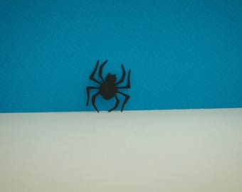 Cut little spider with black design for creating paper