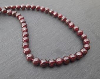 Almandine Garnet: set of 10 round beads 6 mm