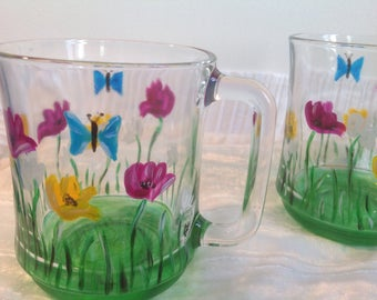 Duo of rustic and spring decor hand painted glass mugs