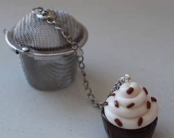 Filter tea, cup cake, chocolate, small cooking pot