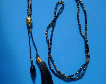 ethnic necklace with glass black tassel and Buddha gold