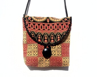 Satchel style graphic and ethnic fabric strap.