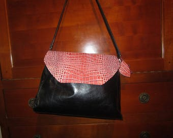 black leather bag has exclusive 2 in 1 pink crocodile flap