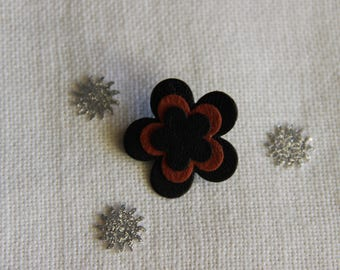 three black and light brown leather flower brooch