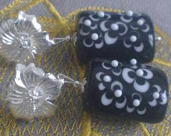 Beads rectangular small white flowers on a black background