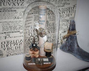 Glass globe and its old sewing items