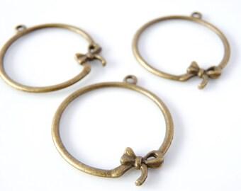 12 charms node 22 x 18 mm - color bronze