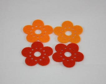 Embellishments/applique/subjects in felt flowers orange and rust