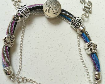 "Bracelet ""Little musicians"" tubular silver plated metal and multicolored cotton cord."