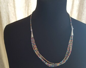 multicolored seed beads and silver necklace