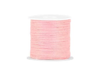 Peach X 2 metres of pink cotton thread, making friendship bracelets