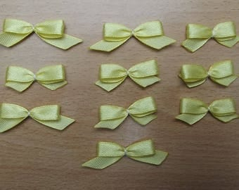 Set of 10 yellow bows for your scrapbooking creations.