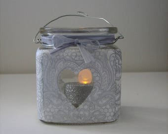 Gray paper covered with glass candle