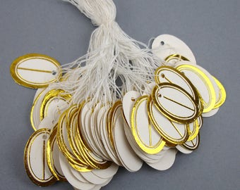 100 white and Gold Oval price tags