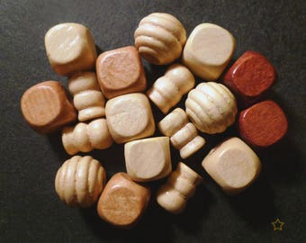Various shapes of beige, Brown wooden beads