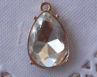 Charm drop faceted glass and gilded 2.50 cm in height.