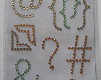 Decorations in rhinestones for cell phone pouch - patterns signs (at sign bracket etc.)