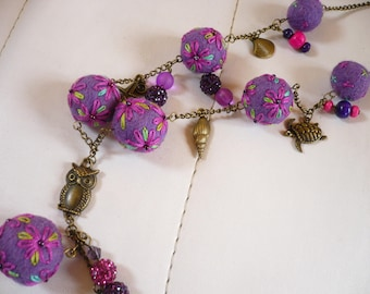 necklace made of wool felt and embroidered with color beads purple pink and green