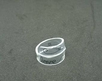 """""""Love"""" ring made of transparent plastic"""