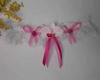 Fuchsia with artificial Orchid and white garter