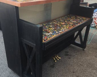Beer bottle cap bar made from an old piano