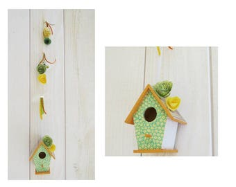 One decorative birdhouse in green and yellow child's room
