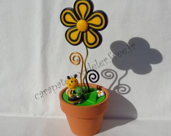 Black and yellow flower pot and bee photo holder