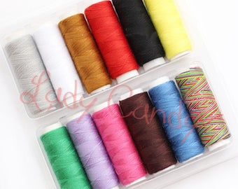 The essential set of 12 spools of thread 200 m has sewing machine and hand #330170