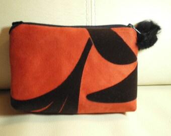 small cosmetic case in orange suede and black velvet