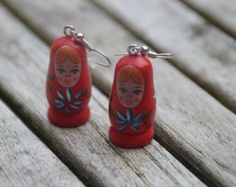 Red Matriochkas earrings decorated with blue flowers