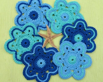 6 glasses, saucer, cup shaped flowers mat underneath made in blue cotton crochet