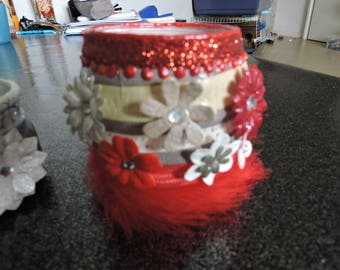 Candle red and multiple feathers flowers