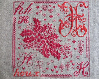 Red embroidery as Holly cross stitch