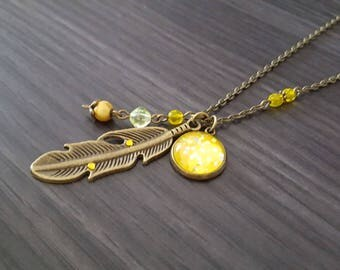 Large yellow feather necklace